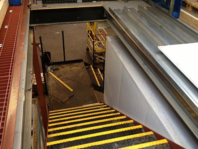 interior steel stairs in warehouse extension