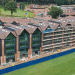 drone image of old thorns manor hotel apartment block under construction
