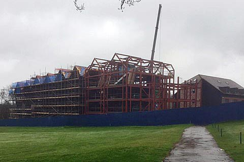 steel structure of old thorns manor hotel seen from golf course