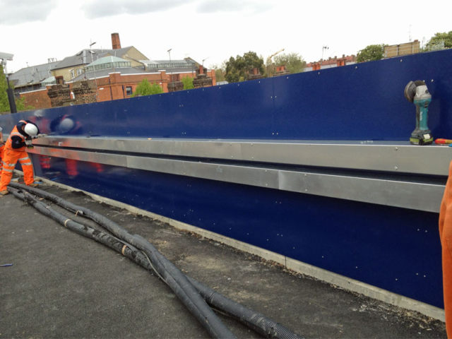 instaling ducting on new parapet marcon place railway bridge designed fabricated and installed by bs steels