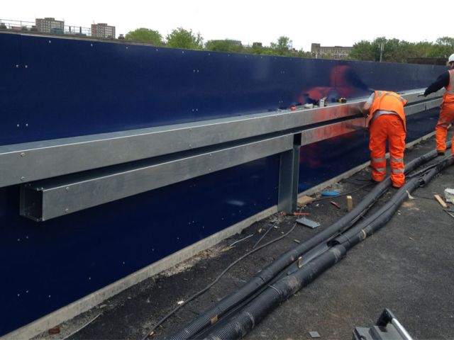 installing ducting on new parapet marcon place railway bridge designed fabricated and installed by bs steels