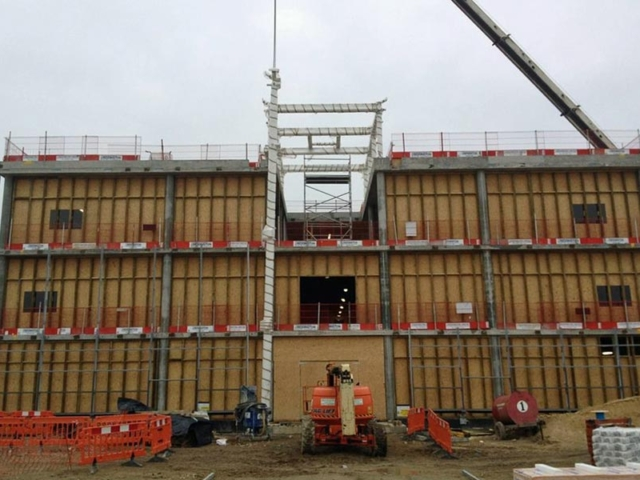 front view of framework of London Gateway reception building during assembly