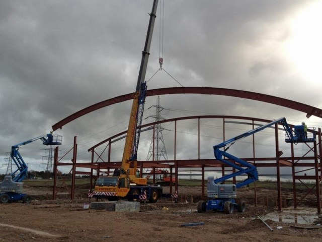 roof span being lifted into place north kent community church
